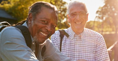 two senior men friends on hike