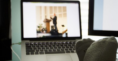 feet up watching church online due to coronavirus
