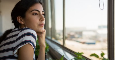 young woman looking wistfully out a window, for those who haven't done great things for God