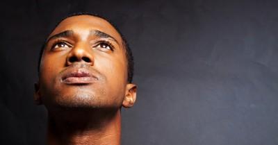 man looking up in prayer