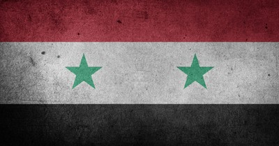 Syrian flag, school headmaster is facing a possible execution for his Christian faith