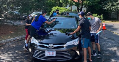 Teens washing a car, Teens host car wash to raise funds for Beirut explosion victims