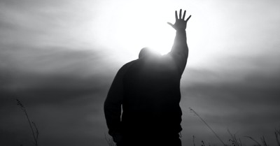 A man with his hands in the air in praise, An Ohio mayor surrenders his city to the Lord