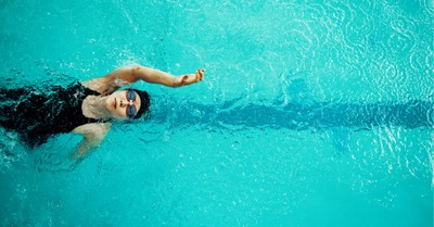 A girl doing a backstroke, bill proposes defunding schools that allow biological males who identify as female to compete in girls' sports