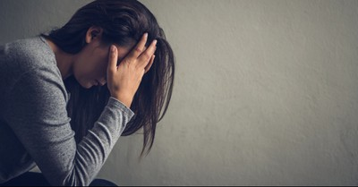 Woman crying into her hands