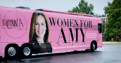 A pink bus with Amy Coney Barrett's face on it, Women gather in D.C. to pray over Amy Coney Barrett
