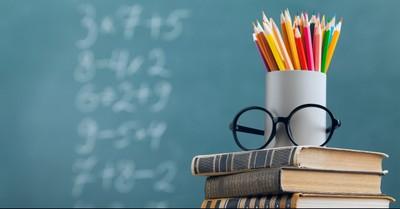 Chalk board, pencils, glasses, books