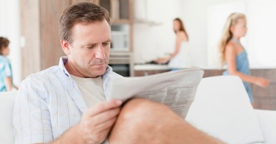 man dad reading the newspaper