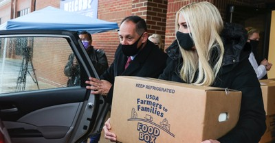Ivanka Trump holding a Farmers to Families food box, Ivanka Trump and Paula White Hand out boxes of food to those in need