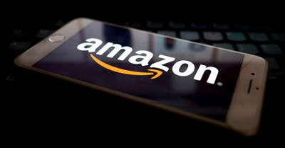 The amazon logo on a phone, Parler sues Amazon