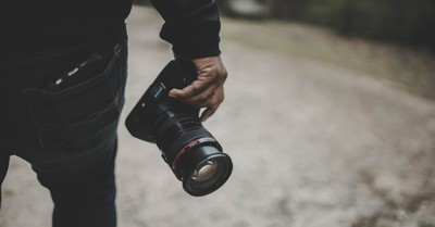 A person holding a camera, Christian photographer challenges Virginia law that could force him to photograph same-sex weddings
