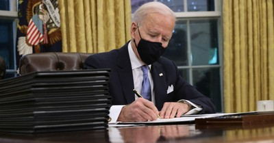 Joe Biden, Biden signs a series of executive orders on his first day in office
