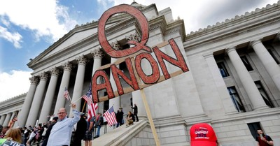 A QAnon sign, more than a quarter of White Evangelicals believe in some core conspiracies