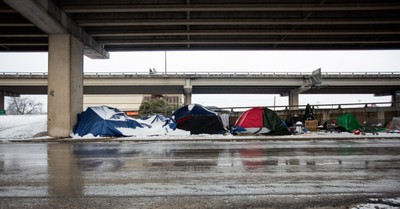 Tents set up under an overpass amid Texas freeze, choosing character today for the crisis tomorrow