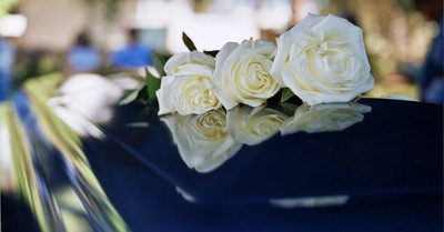 a flower on a coffin, John Baker passes away
