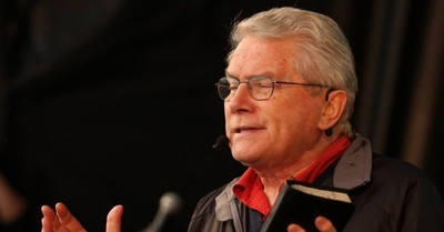 Luis Palau holding a Bible, Christian Leaders respond to the death of Luis Palau