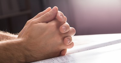 Praying hands, football coach is denied right to pray after games