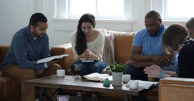 diverse Bible study sitting around coffee table
