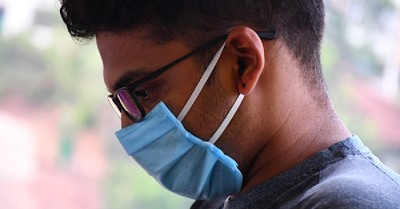 A man wearing a face mask, Do COVID vaccines present ethical concerns?