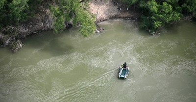 Border patrol agent in the Rio Grande, Texas Rangers and Border Patrol Rescue 6-Month-Old Who Was Dumped in a River by Smugglers