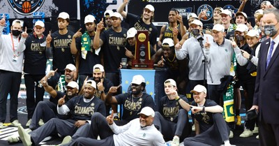 Baylor Bears posing with the NCAA Championship trophy, Baylor Coach Credits Team's Faith and Selflessness for National Title
