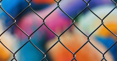 a close up of a fence, Canadian officials barricade a church to prevent services