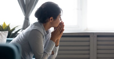 a pensive woman, suicide rate dropped in the US in 2020
