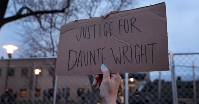 Justice for Daunte Wright sign, Faith leaders speak out following the death of Daunte Wright