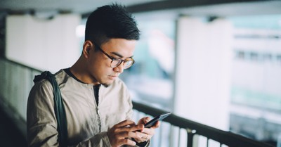 A man on a phone, The CCP is set to roll out a new app where citizens can report those they believe hold a 'mistaken opinion'