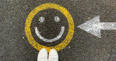 A smiling face drawn on the pavement, Americans are more optimistic than they have been in 15 years