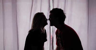 A young couple facing each other, Evangelicals and casual sex