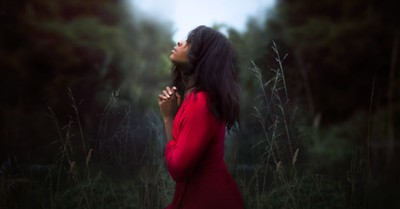 a woman praying, why you should keep praying for your children who are hostile toward your faith