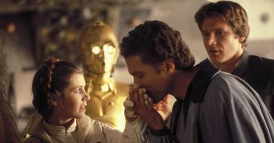 Lando Calrissian kissing Princess Leia's hand, Lucusfilm says Calrissian is a member of the LGBTQ community