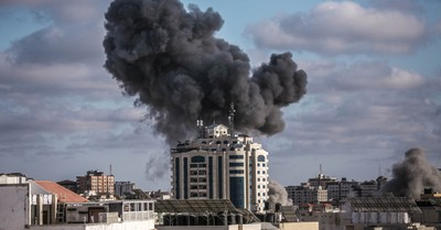 smoke rising from a building in Gaza, World leaders continue to call for a cease-fire