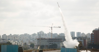 Iron Dome launching its anti-missile system to intercept a rocket, Christians help build thousands of bomb shelters in Israel