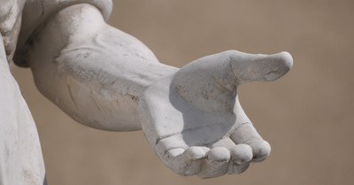 A hand on of a statue, Whitman College students call for the removal of a Marcus Whitman statue