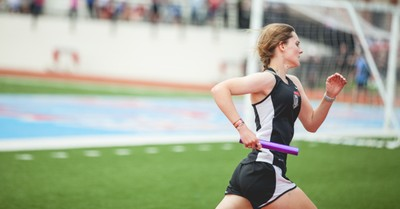 A girl running in a track event, DOE rules schools must allow transgender athletes access to bathrooms and sports corresponding to their self-identified gender