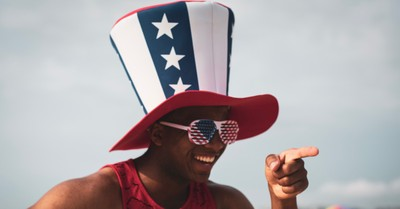 A man in USA hat and glasses, A new report found that red states are more patriotic than blue states