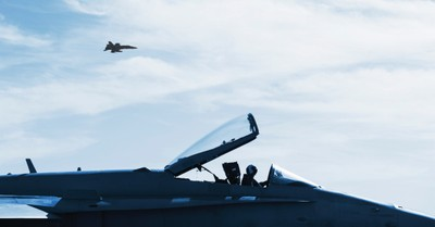 A fighter jet flying in the sky, U.S. launches airstrike on Iraq and Syria