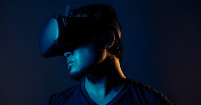 a person wearing a VR headset, the simulation hypothesis
