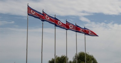 A line of North Korean flags, a report finds religious persecution, sex-trafficking and genocide in North Korea