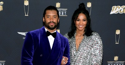 Russell Wilson and Ciara on a red carpet, Photo goes viral of the Wilsons praising God while at church