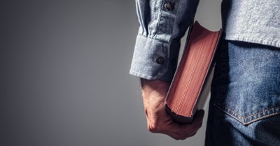 A man holding a Bible, Apologist Josh McDowell to steps back from ministry