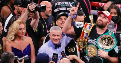 Tyson Fury holding heavyweight boxing championship belt, Tyson Fury praises God after winning championship