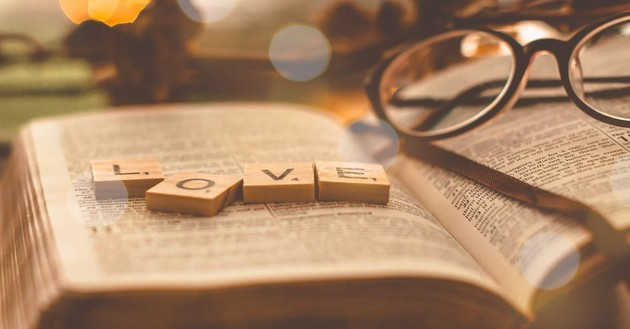 love spelled out in scrabble pieces on Bible, quotes about love