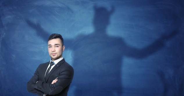 business man with shadow of devil behind reprobate mind