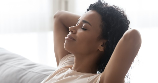 woman with eyes closed in a peaceful healing mindset