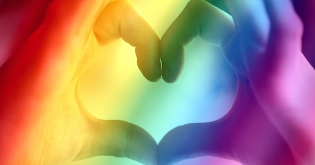 hands forming heart cast in rainbow lights gay marriage