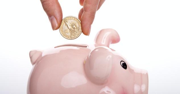 pink piggy bank and a coin