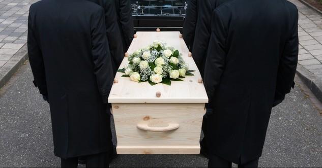 Ushers carrying a casket